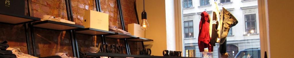 Belysning i klädbutik med nakna glödlampor